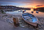 Boats at picturesque Mousehole harbour, in the west of Cornwall.  Captured from the harbour side, at sunrise in late April.
