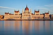 Sunset at the Hungarian Parliament in Budapest, Hungary.
