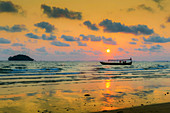 Fishing boat moored off beach south of the city at sunset, Otres Beach, Sihanoukville, Cambodia, Indochina, Southeast Asia, Asia