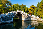 View of arched bridge on Kunming Lake at Yihe Yuan, The Summer Palace, UNESCO World Heritage Site, Beijing, People's Republic of China, Asia