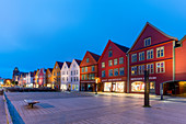 Illuminated timber buildings at dusk, Bryggen, UNESCO World Heritage Site, Bergen, Hordaland County, Norway, Scandinavia, Europe
