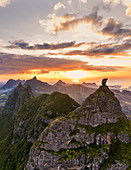 Dramatic sky at sunset over Pieter Both and Le Pouce mountain, aerial view, Moka Range, Port Louis, Mauritius, Africa
