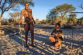 Tourist walk with San Bushmen at Meno a Kwena camp, Kalahari, Botswana, Africa