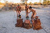 San Bushmen dancing and playing games around a fire, Kalahari, Botswana, Africa