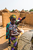 Local girls at a water well in Yaama, Niger, West Africa, Africa