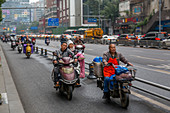 View of motor cyclists in Xi'an city centre, Xi'an, Shaanxi Province, People's Republic of China, Asia
