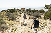 children hiking on Chimney Rock trail, through a protected canyon landscape
