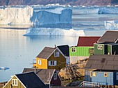 View of fjord full of icebergs towards Nuussuaq (Nugssuaq) peninsula during midnight sun. The town Uummannaq in the north of West Greenland, located on an island  in the Uummannaq Fjord System. America, North America, Greenland