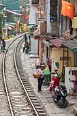 View of Hanoi train street between Le Duan and Kham Thin Street in Hanoi old quarter, Hanoi, Vietnam, Asia