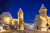 Winter dawn at the city gates in Tallinn old town, Estonia.
