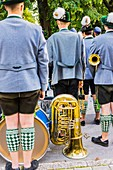 Bavarian marching band dressed in traditional garment on the occasion of the partenkirchner festwoche during the traditional parade, garmisch-partenkirchen, bavaria, germany