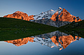Wellhorn and Wetterhorn in the alpenglow are reflected in mountain lake, Grosse Scheidegg, Grindelwald, Bernese Oberland, UNESCO World Natural Heritage Swiss Alps Jungfrau-Aletsch, Bernese Alps, Bern, Switzerland