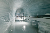 Ice Palace, tunnel made of ice with people in the background, Jungfraujoch, Bernese Oberland, UNESCO World Natural Heritage Swiss Alps Jungfrau-Aletsch, Bernese Alps, Bern, Switzerland