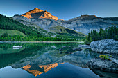 Les Diablerets in first light are reflected in Lac de Deborence, Lac de Deborence, Bernese Alps, Valais, Switzerland