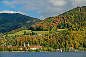 View over the Tegernsee to St. Quirin Monastery Church and Tegernsee Monastery, Tegernsee, Upper Bavaria, Bavaria, Germany