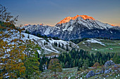 Alpenglow at the Watzmann, autumn-colored trees in the foreground, Berchtesgaden, Berchtesgaden National Park, Berchtesgaden Alps, Upper Bavaria, Bavaria, Germany