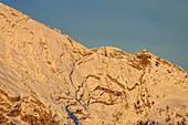 Alpenglow on snow-covered Watzmann with Watzmannhaus, Berchtesgaden, Berchtesgaden National Park, Berchtesgaden Alps, Upper Bavaria, Bavaria, Germany