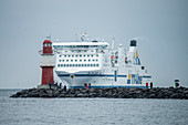 Cruise ship in front of lighthouse at the port of Rostock, Germany, Mecklenburg-Western Pomerania, Baltic Sea