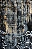 Long icicles on a rock in the light, Nybodarna, Lapland, Sweden