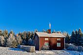 Typical Swedish house in deep winter, near Dorotea, Västerbottens Län, Sweden