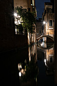 View of a small canal with with bridge and boats in the evening in San Marco, Venice, Veneto, Italy, Europe