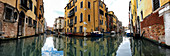 Panorama of a canal with boats in Cannaregio, Venice, Veneto, Italy, Europe