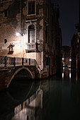 View of a canal with bridge at night in San Marco, Venice, Veneto, Italy, Europe
