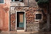 View of a facade with an entrance door in Cannareggio, Venice, Veneto, Italy, Europe