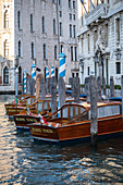 Detail view of wooden boats on the Grand Canal, Venice, Veneto, Italy, Europe