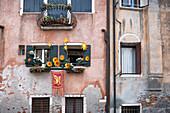 View of a facade amit decorated windows in Cannaregio, Venice, Veneto, Italy, Europe