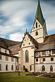 Kreuzgarten with a view of the church tower, Blaubeuren monastery, Alb-Donau district, Baden-Württemberg, Germany