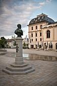 Sculpture looks out over historical building at Leopoldsplatz in Sigmaringen, Baden-Wuerttemberg, Danube, Germany