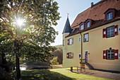 Zwiefaltendorf Castle with a blooming chestnut tree near Riedlingen, Biberach district, Baden-Württemberg, Danube, Germany