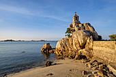 Beach and chapel on a rock, Port Blanc, Cote de Granit Rose, Cotes d'Armor, Brittany, France