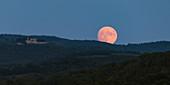 Moon rise in Chianti, east of Pogibonsi, Tuscany, Italy