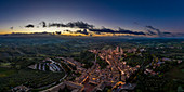 Bird's eye view of sunrise over San Gimignano, Province of Siena, Tuscany, Italy