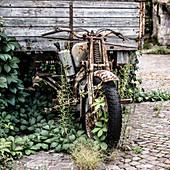 Rusted motorcycle in Garda, Verona Province, Italy