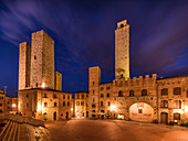 Evening mood at Piazza della Duomo, San Gimignano, Province of Siena, Tuscany, Italy