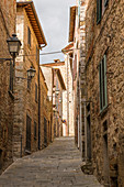 In the narrow streets of Lucignano, Arezzo Province, Tuscany, Italy