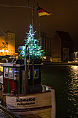 Fishing cutter in the port of Heiligenhafen at Christmas time, Baltic Sea, Ostholstein, Schleswig-Holstein, Germany