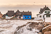 View of the houses of the Graswarder in Heiligenhafen during a north-east storm, Baltic Sea, Ostholstein, Schleswig-Holstein, Germany