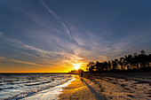 Walk into the sunset on the beach of Kellenhusen, Baltic Sea, Ostholstein, Schleswig-Holstein, Germany