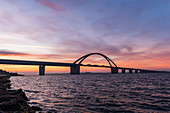 View of the Fehmarnsund Bridge at the blue hour in the morning, Fehmarn, Ostholstein, Schleswig-Holstein, Germany