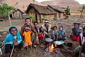 Family by the evening fire, near Ampefy, Merina tribe, highlands, Madagascar, Africa
