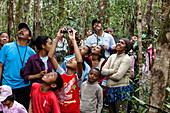 Tourists in the rainforest of Ranomafana, Ranomafana National Park, Madagascar, Africa