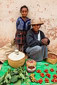 Woman offers vegetables for sale, Sendrisoa, Ambalavao Region, Central Highlands, Madagascar, Africa