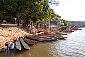 People and boats on the Manambolo River, Tsingy-de-Bemaraha National Park, Mahajanga, Madagascar, Africa