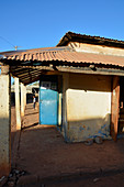 Gambia; Central River Region; Kuntaur; Shop building on the main street; Boy in the background is watching us
