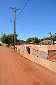 Gambia; Central River Region; Kuntaur; Main street at the entrance to the village; Rest in the midday heat