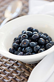 Blueberries in a white bowl. Algarve, Portugal.